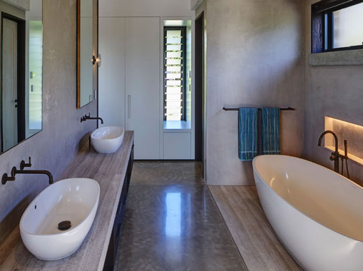 A modern bathroom interior with polished concrete flooring